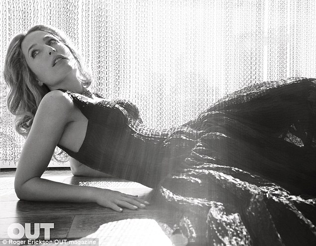 Gorgeous: Gillian Anderson poses in a floor-length gown with corseted bodice in the new edition of Out magazine