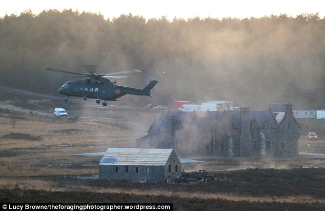 Sky high: A helicopter hovers above the film set
