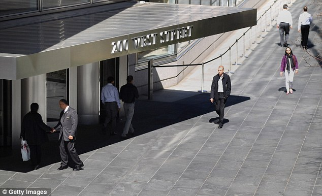 Reeling: People walk past the Goldman Sachs headquarters. Commentators have suggested that the conditions described by Smith are commonplace on Wall Street