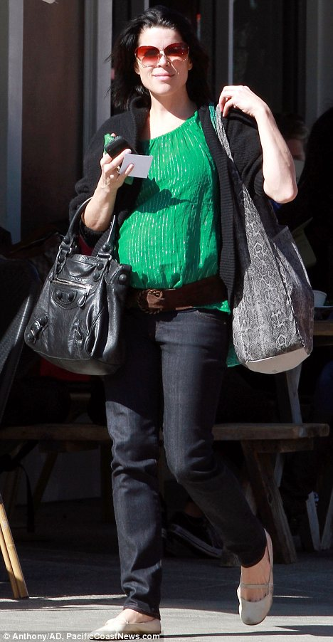 Something to Scream about: The actress showed off her bump in a green top in Los Angeles yesterday