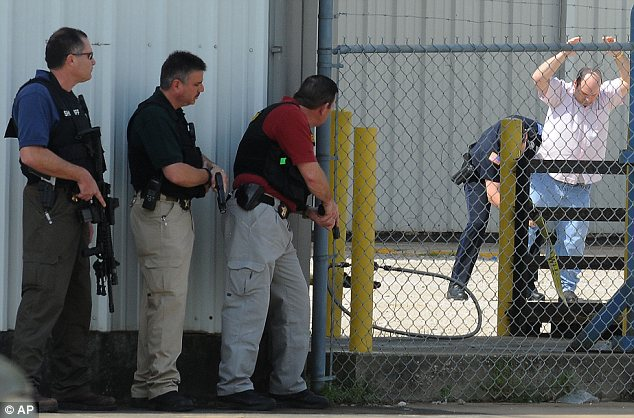 Standoff: Police marksmen stake out the building where Granger held several people hostage