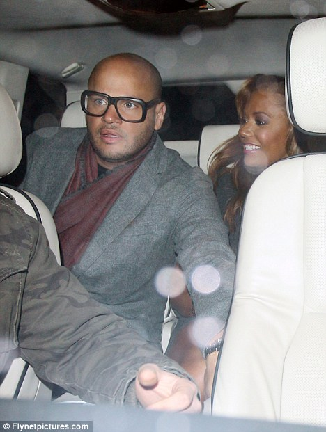 Silly specs: Mel Brown and husband Stephen Belafonte seen after the show