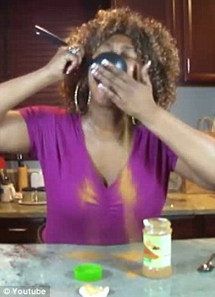 Easy does it: A woman who posted her Cinnamon Challenge on YouTube spoons a ladle of the powdered spice into her mouth