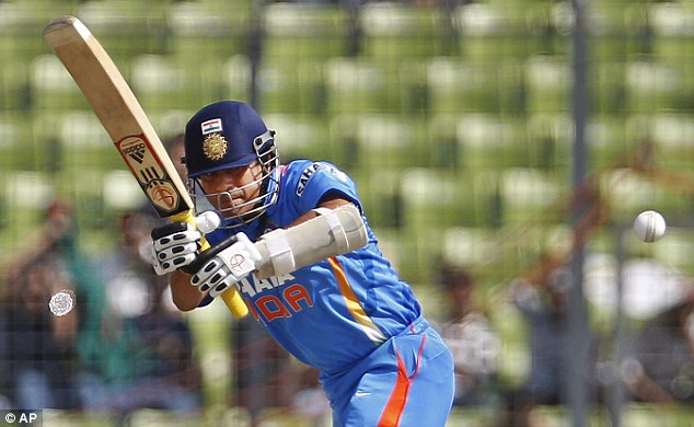 Watching it all the way: Tendulkar in action during the Asia Cup game against Bangladesh in Dhaka