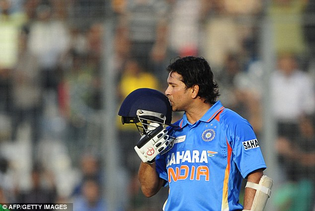 Sealed with a kiss: Tendulkar kisses his helmet after reaching his milestone