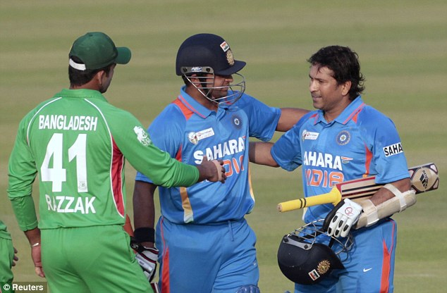 Good job: Tendulkar is congratulated by Bangladesh's Abdur Razzak