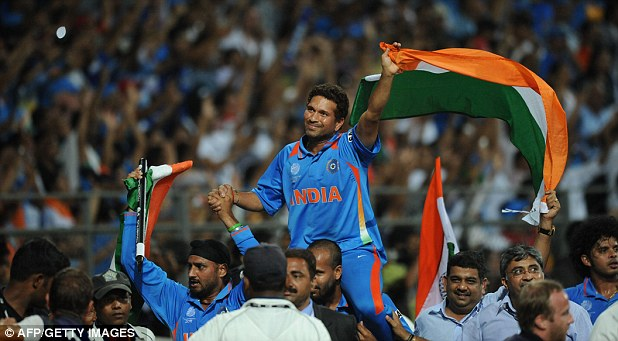 Hero: Sachin Tendulkar as he is hoisted on the shoulder of a teammate after victory in the Cricket World Cup 2011 final over Sri Lanka