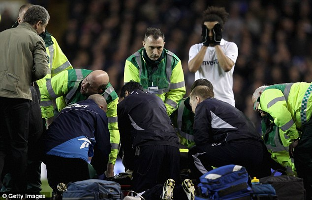 Shock: Benoit Assou-Ekotto cannot look as medics attend to Muamba