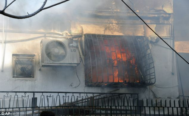 Ruined: Flames rip through Syrian criminal security department after the second explosion