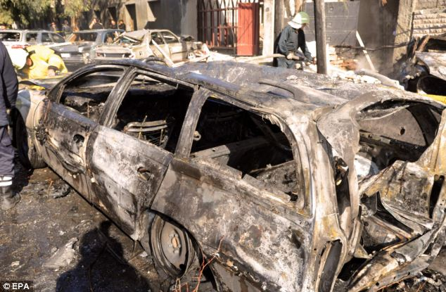 Devastation: The violence in Kassa'a, Damascus, follows around 8,000 killings since the uprising began in Syria
