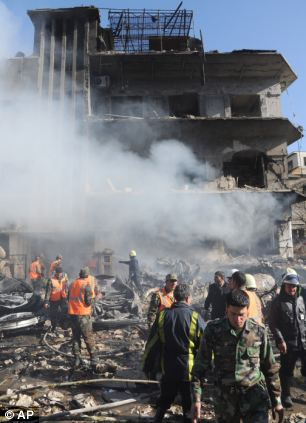 Lost: Soldiers and security officers inspect the damage at the aviation intelligence building, which appeared to have been targeted by one of the two explosions