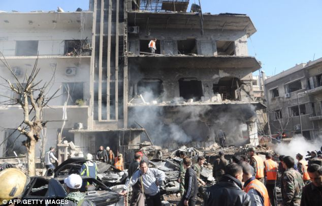 Shocking violence: Syrians were left reeling after the dramatic blasts at security buildings in the heart of the troubled country's capital