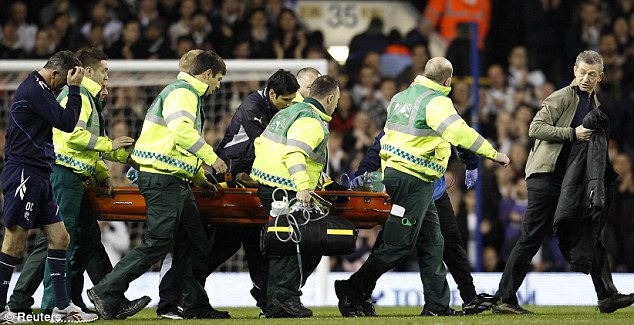 Shock: Bolton manager Owen Coyle (left) walks alongside the stretcher as medical staff attend to Fabrice Muamba. Leading the way, right, is Dr Andrew Deaner, a consultant cardiologist who happened to be at the game