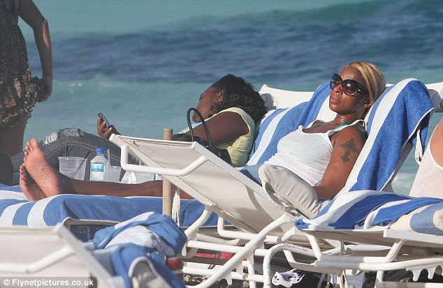 Sleeping time: The superstar singer put her sunglasses on and drifted away as she relaxed in the sun