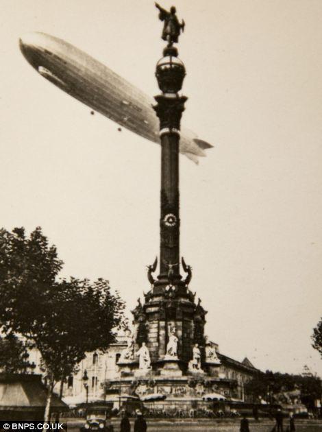 Zepplin over the Christopher Columbus statue in Barcelona