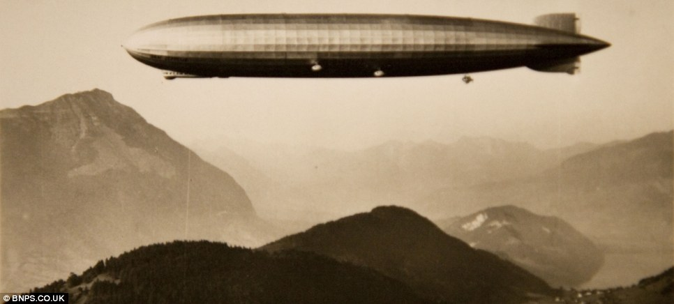 A huge Zeppelin airship darkens the skies over an Austrian valley. This photo forms part of a massive collection owned by David Kirch, from Jersey, which is up for auction