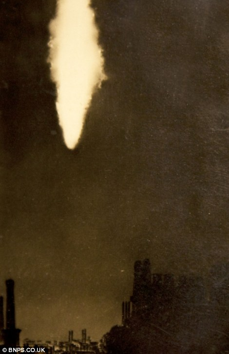 A Zeppelin in flames over London during WWI