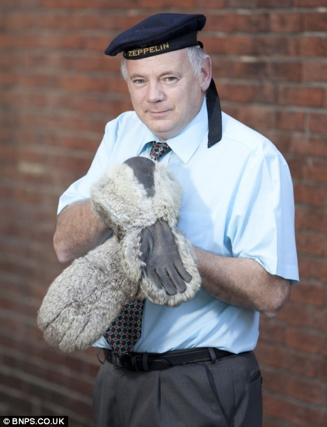 Auctioneer Glenn Butler from Wallis and Wallis Auctions, with Zeppelin crew mittens and hat