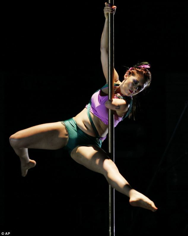 Pole prowess: At the International Pole Championship in Hong Kong, Australia's Deborah Roach slide and swung past her competitors to win first place in the disabled division