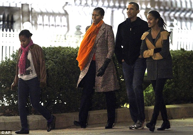 Together: The First Family from left, Sasha Obama, First Lady Michelle Obama, President Barack Obama and Malia Obama, walk together to the Corcoran Gallery of Art in Washington, on Sunday, January 29, 2012