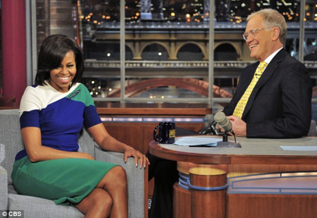 Laughs: First Lady Michelle Obama talks with Late Show host David Letterman during Monday taping in New York