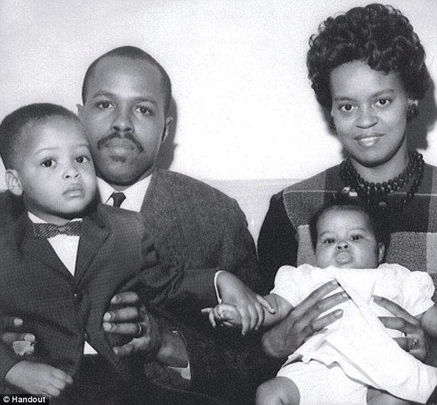 Family: Michelle Obama's father, Fraser Robinson III, pictured with family in an undated photo