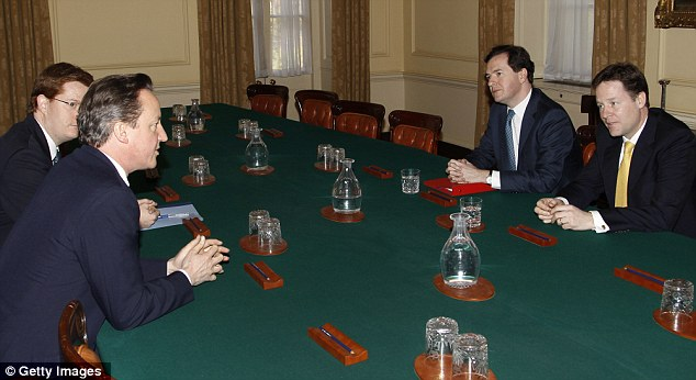 Budget discussions: The quad - (from left to right) Danny Alexander, David Cameron, George Osborne and Nick Clegg - discuss the 2012 Budget in 10 Downing Street yesterday