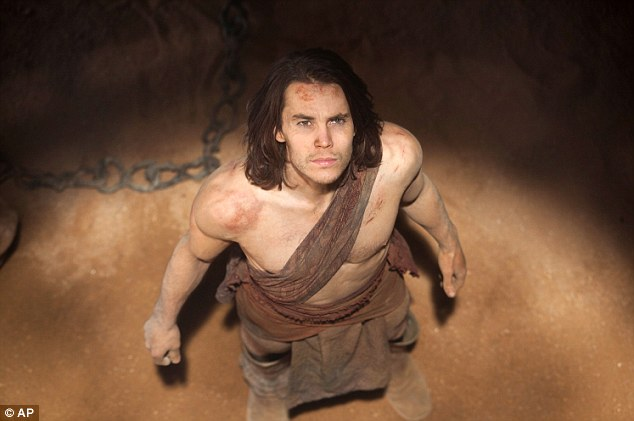 Literary origins: The movie starring model/actor Taylor Kitsch (pictured) was based on a series of books written by the late Edgar Rice Burroughs,