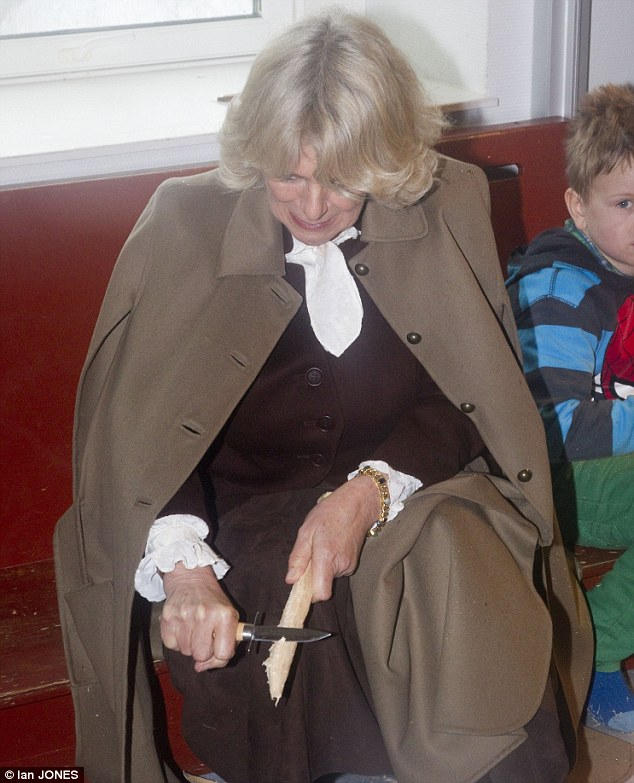 The Duchess of Cornwall and HCamilla met local  children watched campfire cooking and was shown safe wood whittling skills