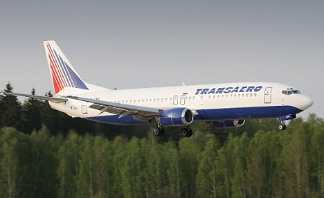 'No risk': After a two-hour delay, the Transaero Boeing 737 took off, with the hole was still left uncovered. The company said it was safe to do so