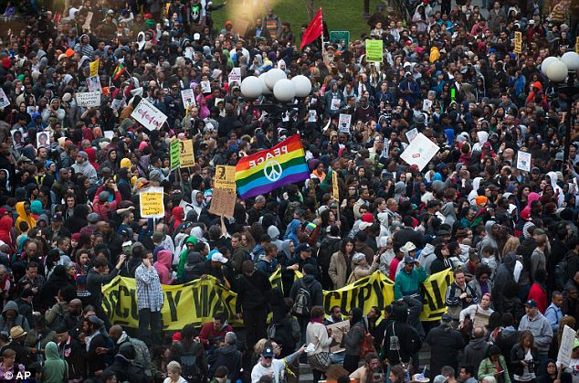 Coming together: Thousands of protesters, some banding together from other causes, attended the Million Hoodie Rally in Manhattan's Union Square on Wednesday
