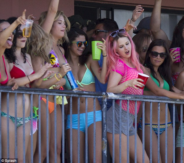 Neon brights: The co-stars flaunted their figures in their usual day-glo bikinis and shorts combinations