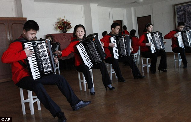 Rehearsal: Students play together at the Kumsong school in Pyongyang, North Korea