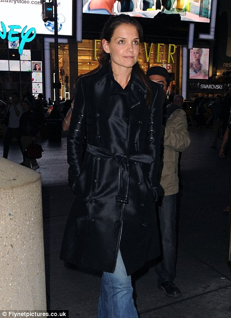 Bright lights: Katie Holmes dressed casually to watch Evita, on Broadway, yesterday, in New York