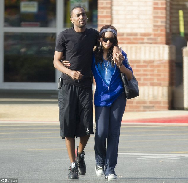 Fresh blow of devastation: Whitney Houston's daughter was seen out in Atlanta with her boyfriend Nick Gordon. The 19-year-old looked devastated as the cause of her mother's death was confirmed