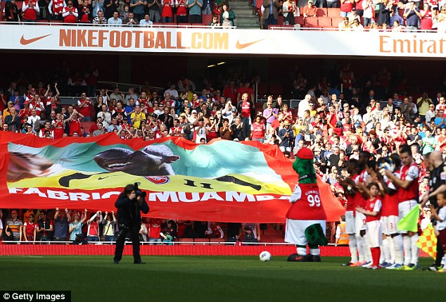 Respect: Arsenal fans and players pay tribute to former Gunner Fabrice Muamba