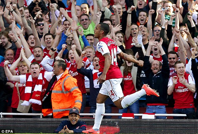 Party time: Theo Walcott takes the plaudits after his strike