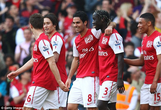 Rejuvenated: Arsenal celebrate Arteta's strike