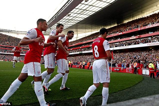Comfortable win: Arsenal players toast Arteta's late strike