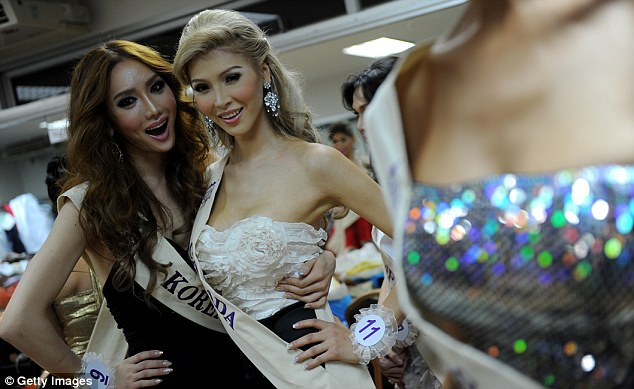 All woman: Jenna Talackova, 23, (pictured right in 2010 with Miss Korea, left) will now be allowed to enter Miss Universe Canada