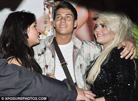 Group hug: Joey was so popular that he had to take photos with two women at a time