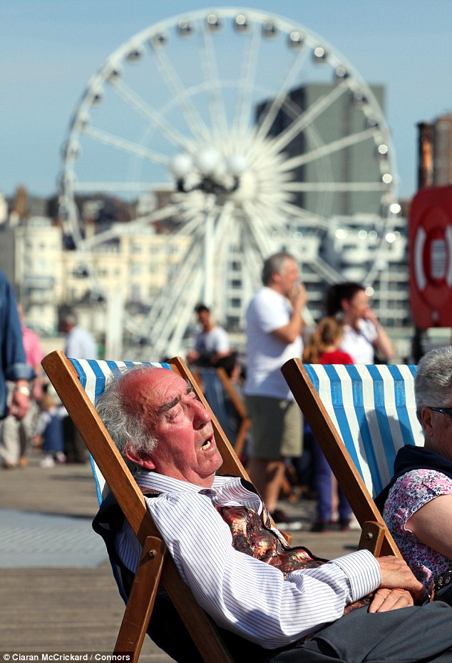 Hot work: The heat was too much for some as the sun-seekers on Brighton beach today basked in balmy temperatures and uninterrupted sunshine
