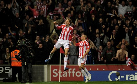 Ecstatic: Peter Crouch celebrates after lashing in his long-range volley against Man City