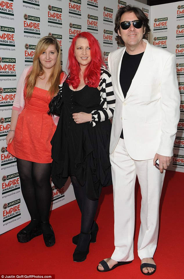 Nice sandals, mate: Jonathan Ross opts for some dodgy footwear as wife Jane steals the show with pink hair