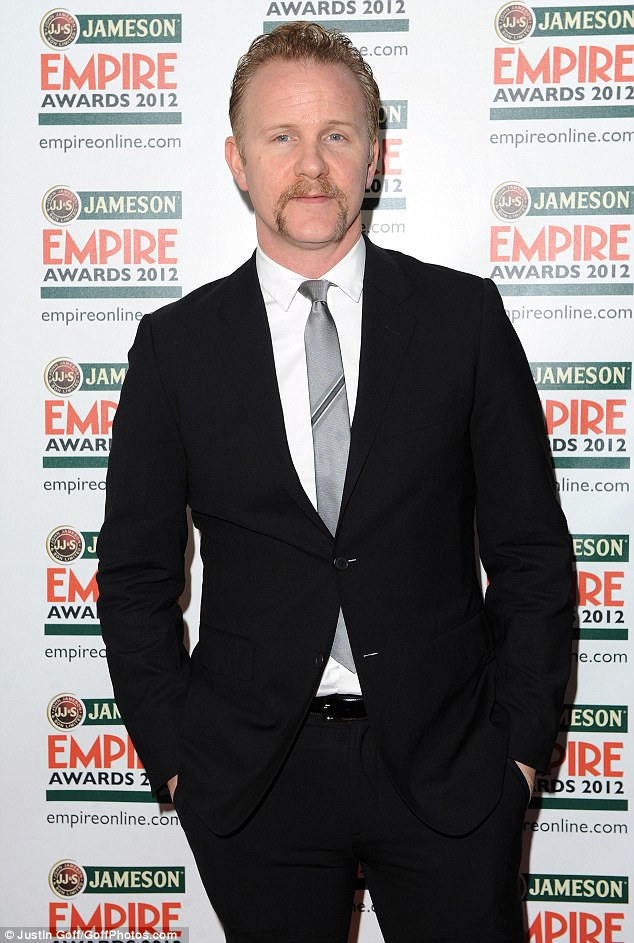 Suited and booted: Morgan Spurlock scrubs up well in his suit and tie