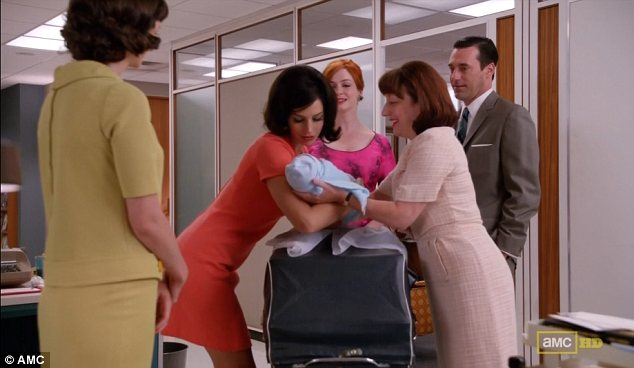 Awkward: Megan clearly tries to avoid saying Hi to Joan but gets dragged over and somehow ends up holding Kevin