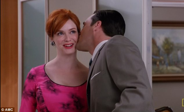 Warm reception: The big chested office beauty is greeted with a kiss from Don