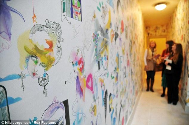 Artist Julie Verhoeven has created wallpaper that features cartoonish sketches of Princess Diana