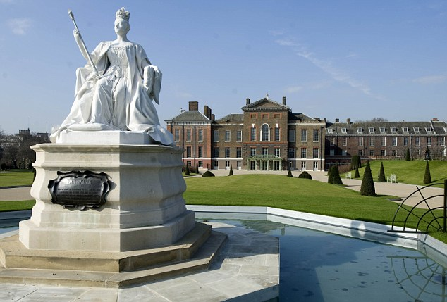 A view of Kensington Palace with the statue of Queen Victoria in the foreground