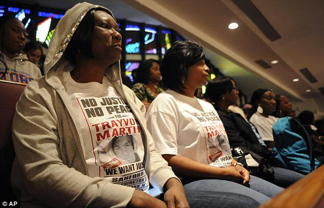 'No justice': Marie Gonzalez, of Pembroke Pines, Florida, wears a T-shirt demanding justice for Trayvon